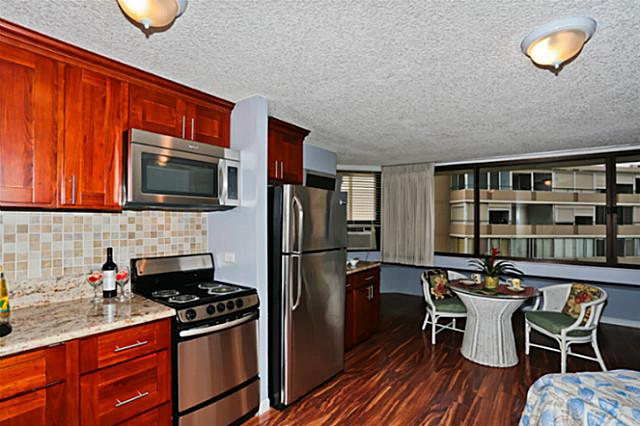upgraded kitchen Waikiki condo studio apartment stainless steel appliances